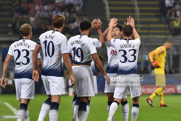 Tottenham's Danish midfielder Christian Eriksen Tottenham's English forward Harry Kane Tottenham's Belgian midfielder Moussa Dembele Tottenham's...