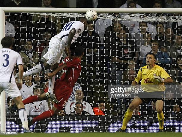 Tottenham's Darren Bent scores his goal beating the goalkeeper Mariusz Pawetek of Wisla Krakow and Cleber of Wisla Krakow during the UEFA Cup first...