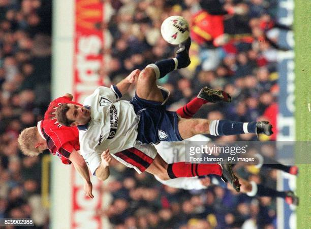 Tottenham's David Howells retrieves the ball in a clash with Notts Forest's Alf Inge Haaland during today's Premiership match at White Hart Lane...
