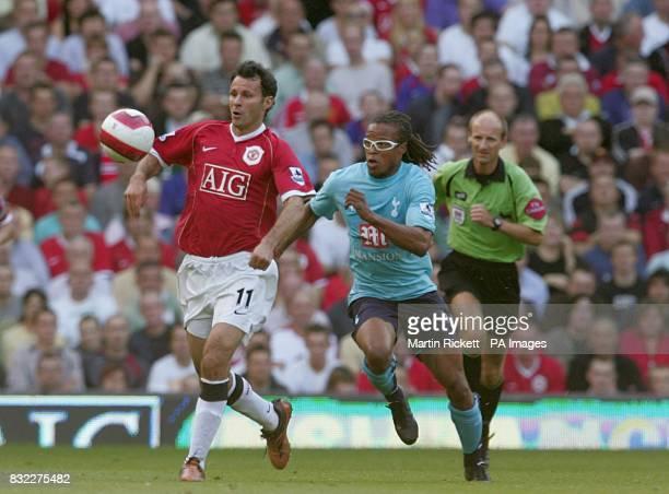 Tottenham's Edgar Davids chases Ryan Giggs of Manchester United