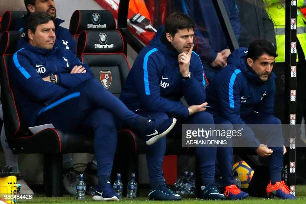 Tottenham's first team coach Miguel D'Agostino Tottenham Hotspur's Argentinian head coach Mauricio Pochettino and assistant manager Jesus Perez watch...