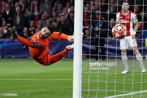 TOPSHOT Tottenham's French goalkeeper Hugo Lloris concedes a goal during the UEFA Champions League semifinal second leg football match between Ajax...