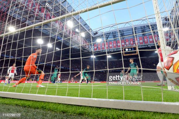 Tottenham's French goalkeeper Hugo Lloris concedes a goal during the UEFA Champions League semifinal second leg football match between Ajax Amsterdam...