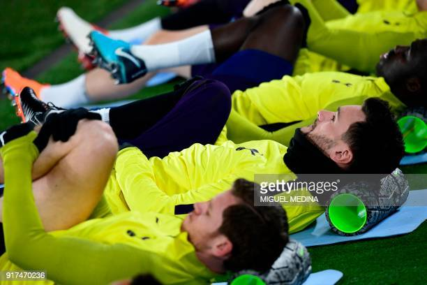 Tottenham's French goalkeeper Hugo Lloris stretches during a training session at Allianz Stadium in Turin on February 12 2018 on the eve of their...