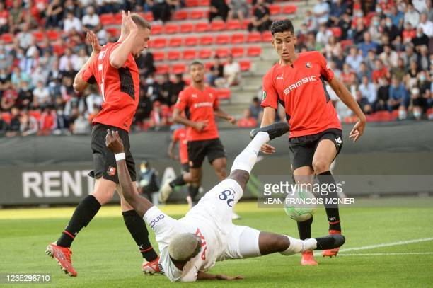 Tottenham's French midfielder Tanguy NDombele Alvaro fights for the ball with Rennes' Moroccan defender Nayef Aguerd and Rennes' French defender...