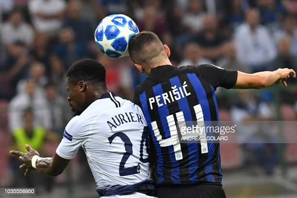 Tottenham's Ivorian defender Serge Aurier and Inter Milan's Croatian midfielder Ivan Perisic go for a header during the UEFA Champions League group...