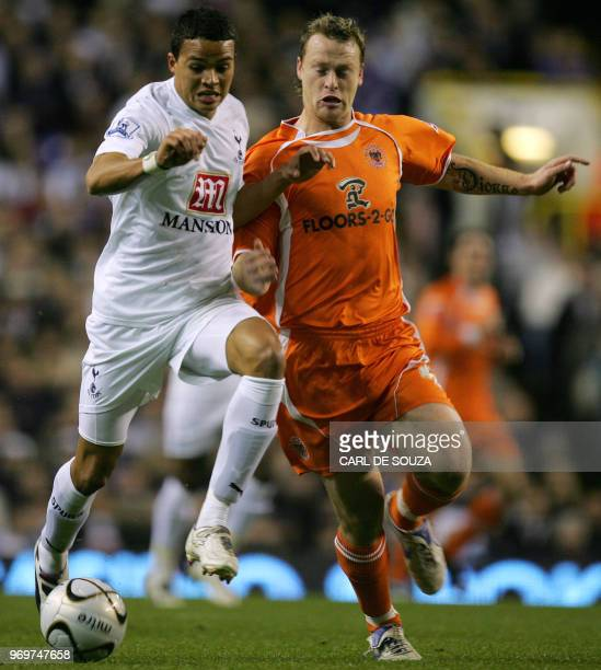 Tottenham's Jermaine Jenas vies with Blackpool's Michael Flynn during their Carling Cup match against Blackpool at home to Tottenham at White Hart...