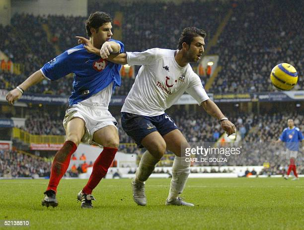 Tottenham's Mido keeps Portsmouth's Dejan Stefanovic at bay during their Premiership match 05 February 2005 at Tottenham Hotspurs grounds. AFP...