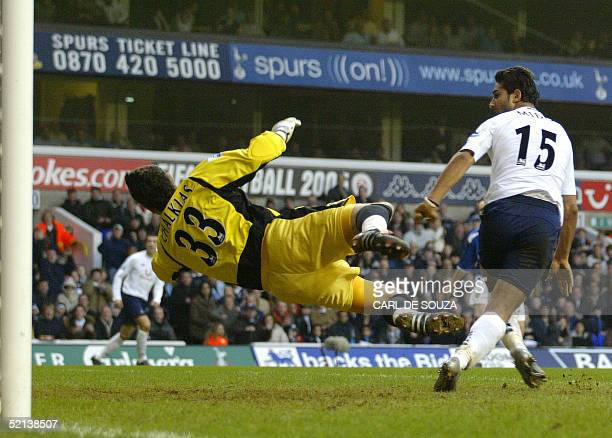 Tottenhams Mido watches Portsmouths Goalkeeper Kostas Chalkias fail to save his goal in his first match for Tottenham during their Premiership match...