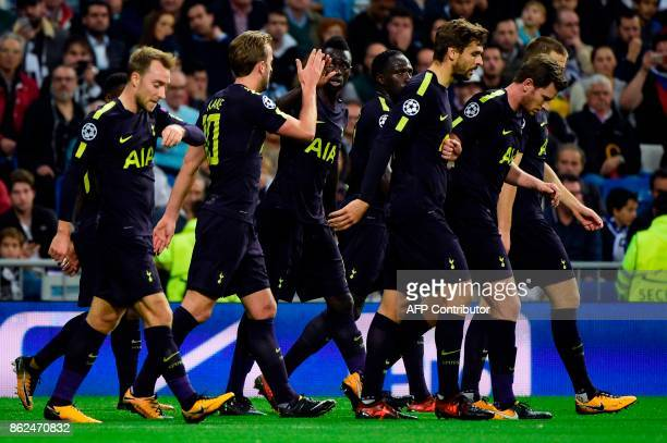 Tottenham's players celebrate after Real Madrid's French defender Raphael Varane scored an own goal during the UEFA Champions League group H football...