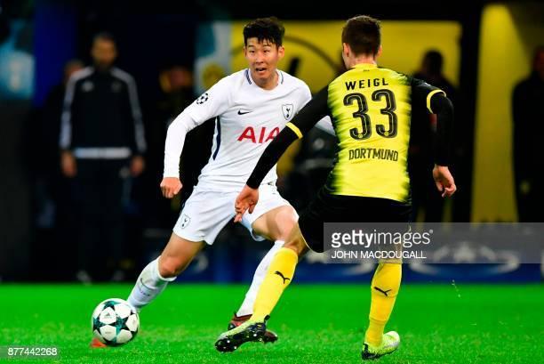 Tottenham's Son HeungMin vies with Dortmund's Julian Weigl during the UEFA Champions League Group H football match BVB Borussia Dortmund v Tottenham...