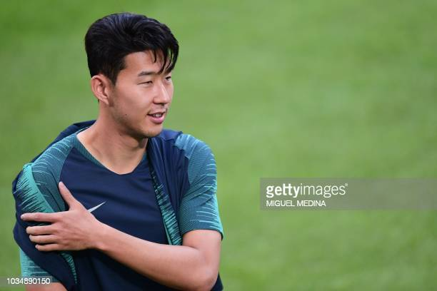Tottenham's South Korean forward Heungmin Son attends a training session on the eve of the Champions League group stage football match Inter Milan vs...