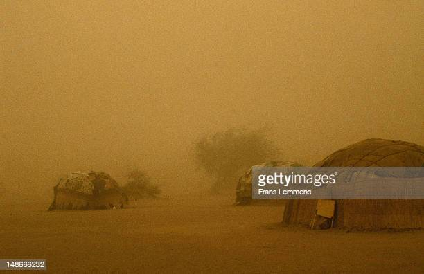 Touareg huts in sandstorm.