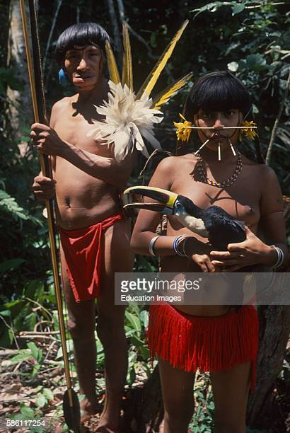 Toucan girl and warrior who has plug of raw tobacco in lower lip Venezuela Ramphastos cuvieri