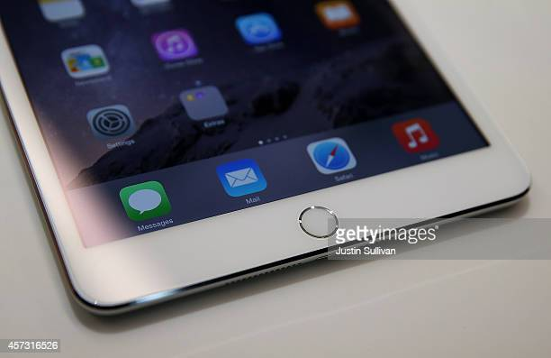 A touch ID pad is seen on the new iPad Mini 3 during an Apple special event on October 16 2014 in Cupertino California Apple unveiled the new iPad...