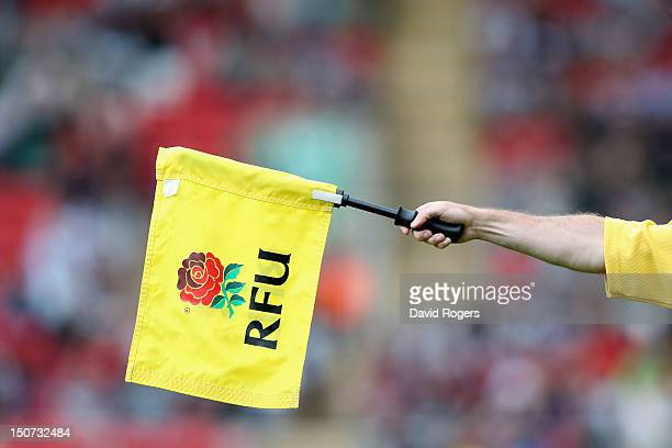 A touch judge waves his flag during the pre season friendly match between Leicester Tigers and Nottingham at Welford Road on August 25 2012 in...
