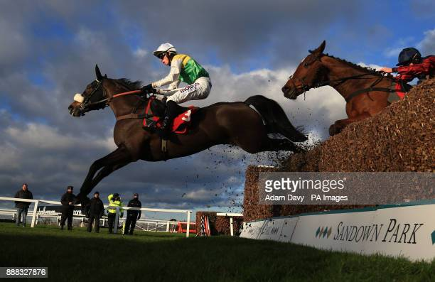 Touch Kick ridden by Harry Cobden jumps the last to win the MS Amlin Insurance Novices' Limited Handicap Steeple Chase during day one of the Betfair...