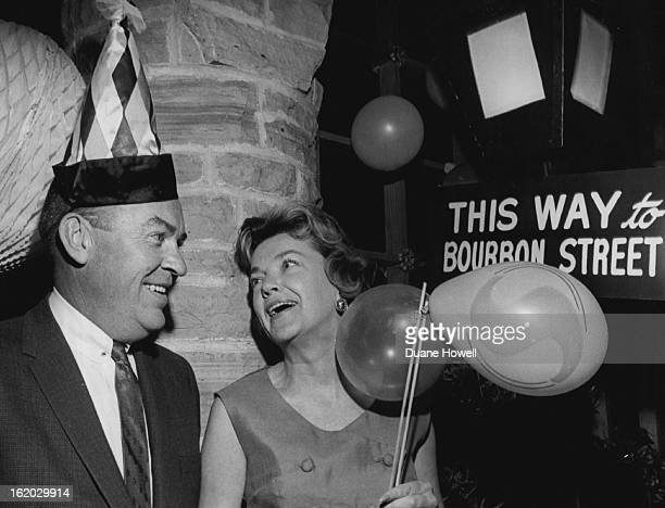 FEB 19 1963 FEB 25 1963 A touch of New Orleans hits Cherry Hills Country Club Dr and Mrs George Masten follow the signs to the fun during the Mardi...