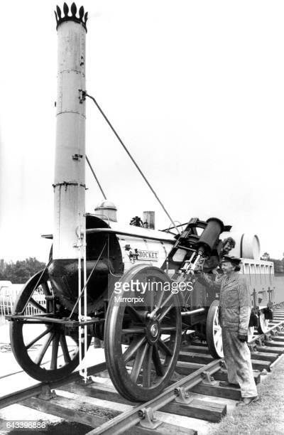 A touch of oil here and ther from Mr John Bellwood of York for the replica of George Stephenson's Rocket whilst his wife Jean stokes the boiler...