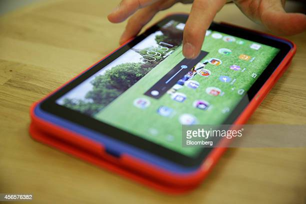 A touch screen 'brightness' slider and icons sit illuminated on a hudl2 Tesco Plc's latest handheld tablet device during its launch in London UK on...