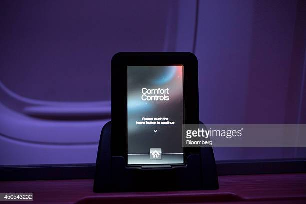 A touch screen remote control sits illuminated in the first class cabin on board an American Airlines Group Inc Boeing Co 777300ER aircraft at Hong...