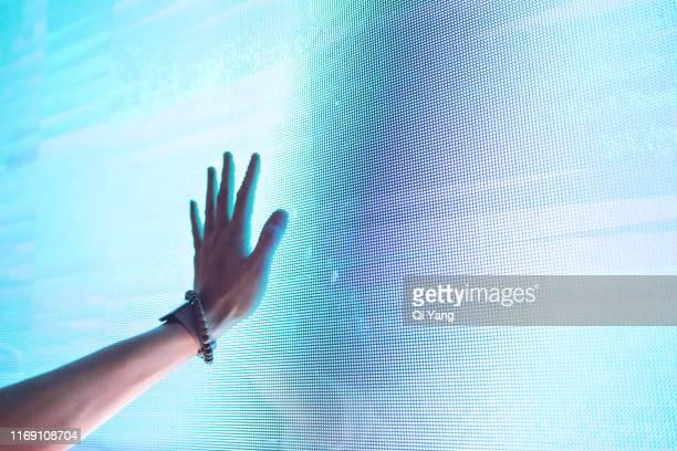 touch the display by hand - gerätebildschirm stock-fotos und bilder