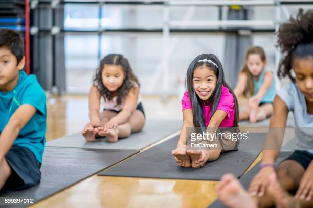 touch your toes - physical education stock photos and pictures