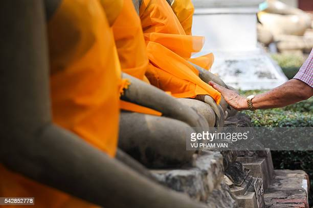 touching hands of buddha statues in ayutthaya - wonderlust stock photos and pictures