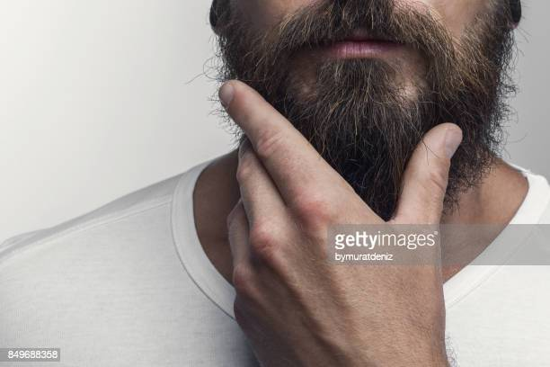 Touching his great beard