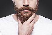 Touching his perfect beard.
