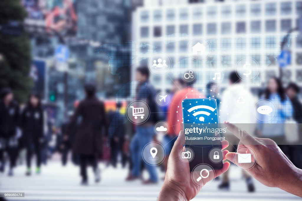 Touching social icon on screen connect internet and network all device technology with city background of business in blue tone, business and technology concept : Photo
