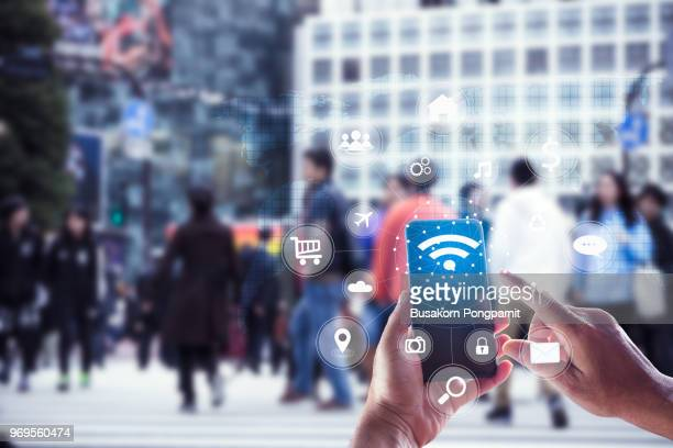 touching social icon on screen connect internet and network all device technology with city background of business in blue tone, business and technology concept - wireless technology foto e immagini stock
