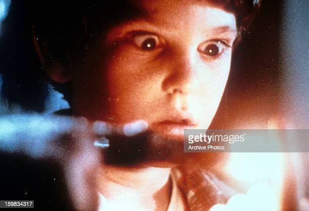 ET touching the finger of Henry Thomas in a scene from the film 'ET The ExtraTerrestrial' 1982