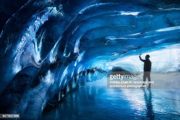 Touching the ice cave of Athabasca glacier