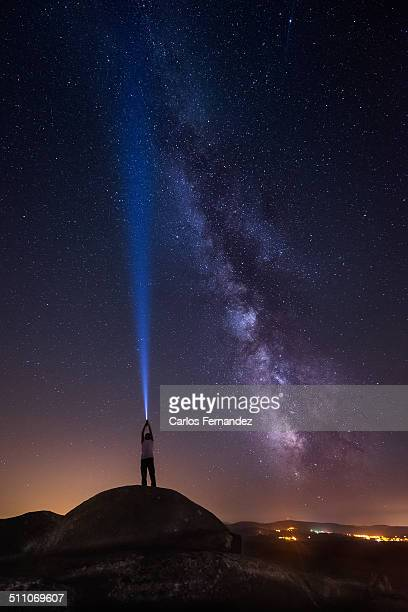 touching the sky ii - lightsaber stock pictures, royalty-free photos & images