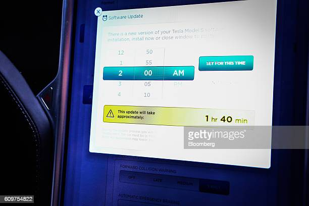A touchscreen control panel displays the Tesla Motors Inc 80 software update information inside a Model S P90D vehicle in the Brooklyn borough of New...