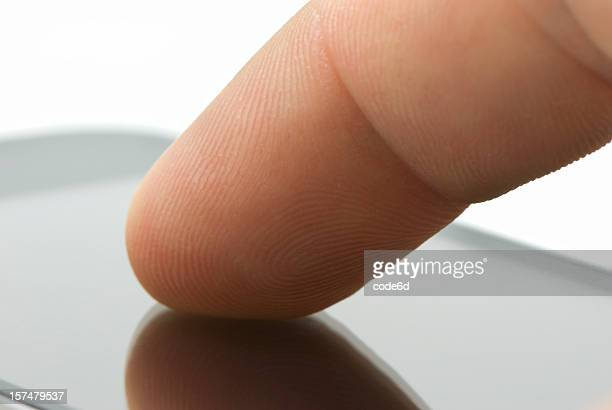 Touchscreen device, finger on surface, close-up, copy space