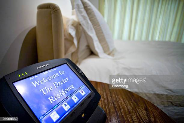 """Touch-screen device which controls lighting and audio reads """"Welcome to The Dreier Residence"""" in the master bedroom of an apartment belonging to Marc..."""