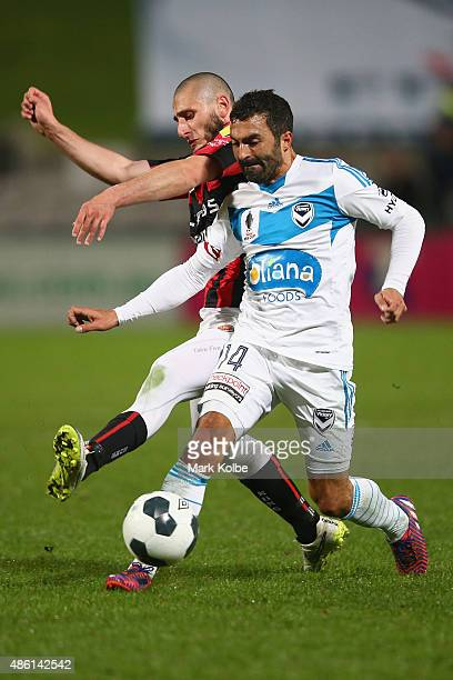 Toufic Alameddine of the Suns and Fahid Ben Khalfallah of the Victory compete for the ball during the FFA Cup Round of 16 match between Rockdale City...