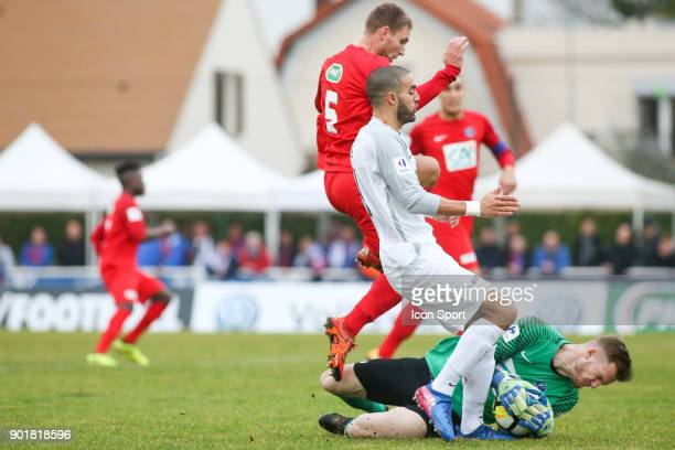 Toufik Bensaada of Houilles and Theo Guivarch of Concarneau during the french National Cup match between Houilles and Concarneau on January 6 2018 in...