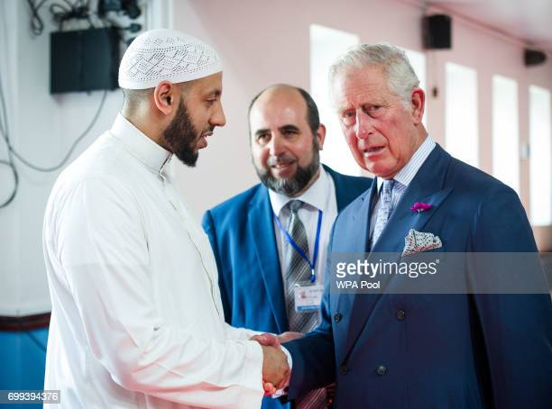 Toufik Kacimi CEO of Muslim Welfare House looks on as Prince Charles Prince of Wales shakes hands with Imam Mohammed Mahmoud who protected the...