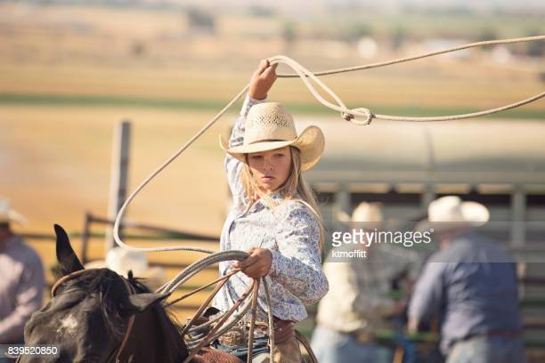 Tough Cowgirl Roping A Steer