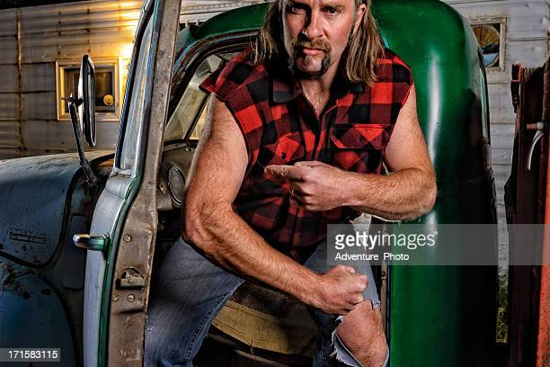 tough guy redneck with mullet - karikatuur stockfoto's en -beelden