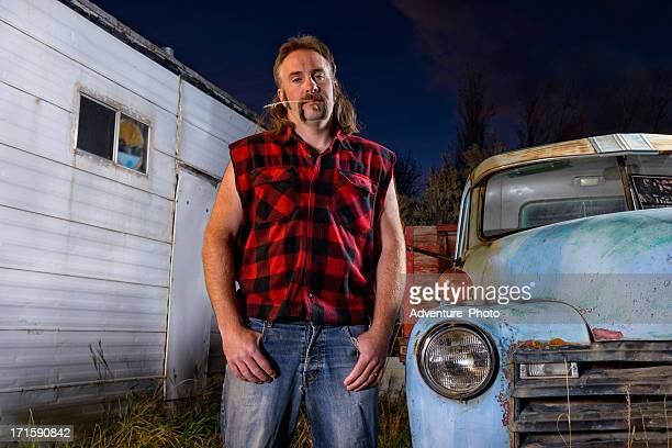 tough guy redneck with mullet - redneck stock photos and pictures