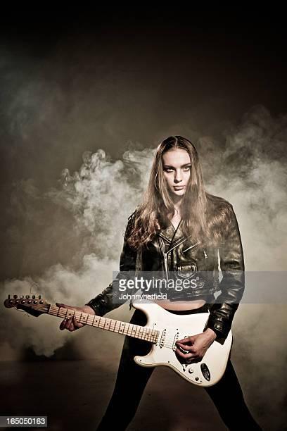 Tough rocker chick holding her guitar