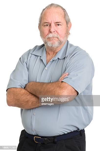 Solide homme Senior traverse les bras