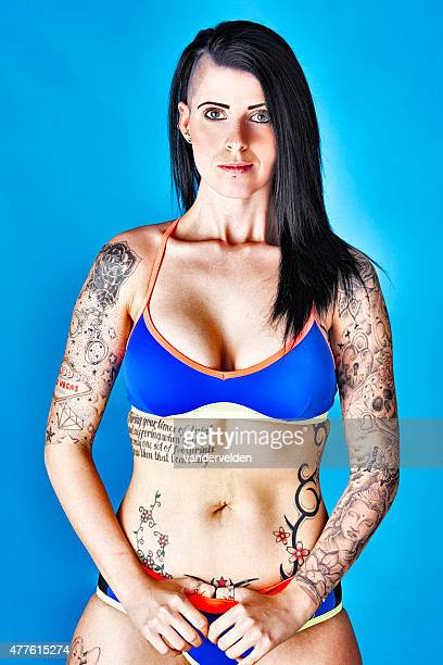 tough woman wearing a sexy bikini - half shaved hairstyle stock pictures, royalty-free photos & images