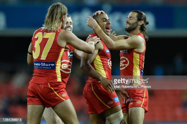 Touk Miller of Gold Coast Suns celebrates kicking a goal during the round 10 AFL match between the Gold Coast Suns and the St Kilda Saints at...