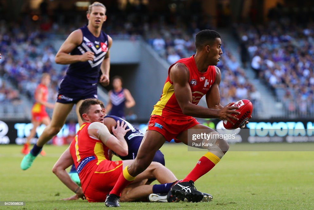 Touk Miller of the Suns looks to pass the ball during the round three AFL match between the Gold Coast Suns and the Fremantle Dockers at Optus Stadium on April 7, 2018 in Perth, Australia.