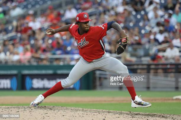 Touki Toussaint of the Atlanta Braves and the World Team pitches in the eighth inning against the US Team during the SiriusXM AllStar Futures Game at...